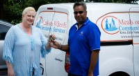 Ms Drina Engelbrecht hands keys the keys of their brand new vehicle to MOWCS KNFSA Director Gershon Naidoo